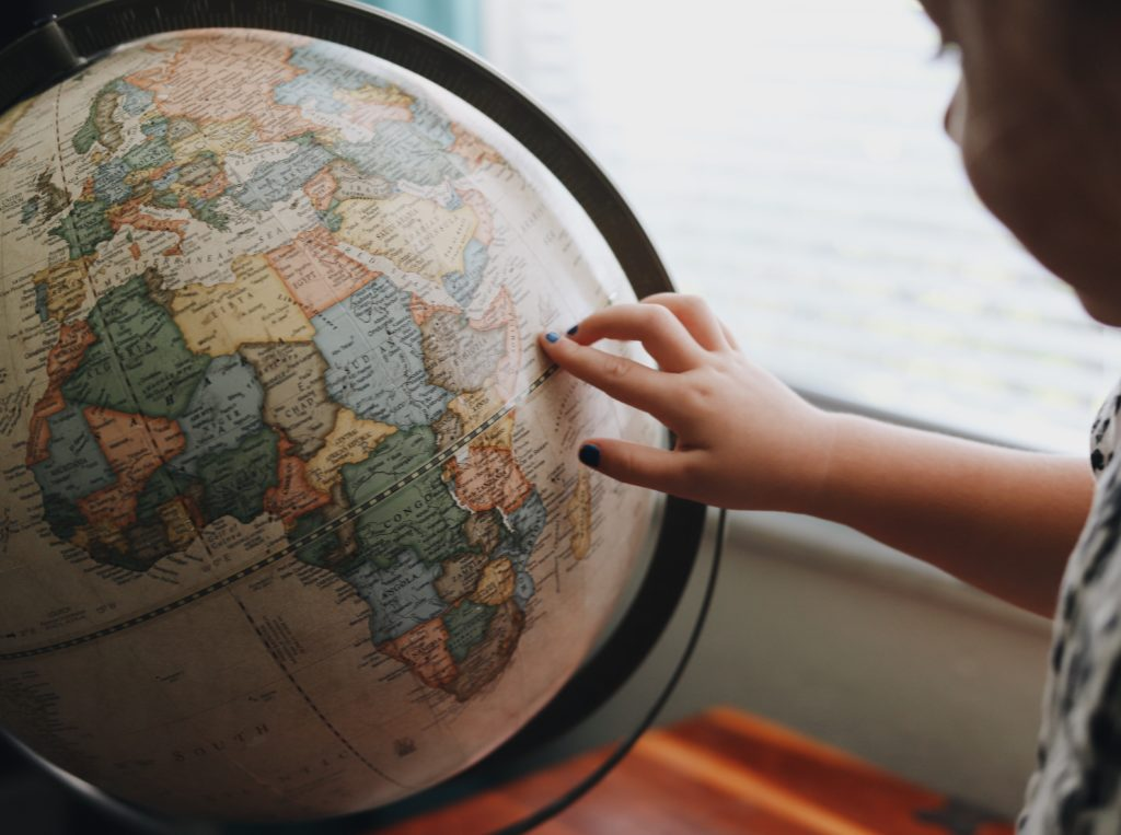 Private tutors availability globally during coronavirus pandemic: child points at globe